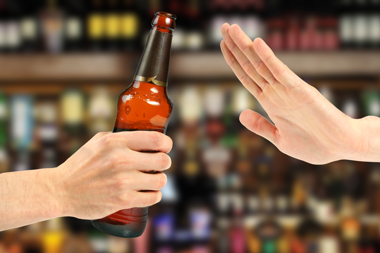 Hand saying no to beer