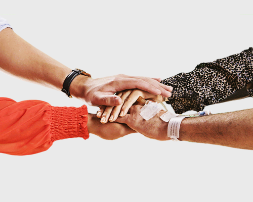 group with hands in together