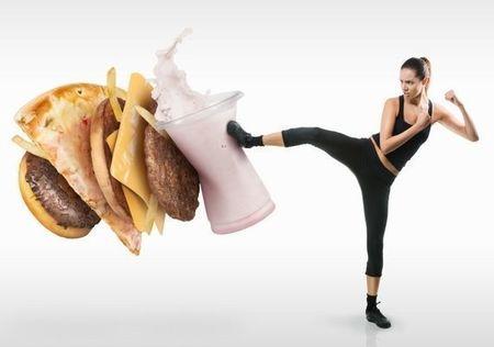 Small lady kicking junk food 570x400